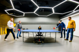 levi9 team playing table tennis in gaming room
